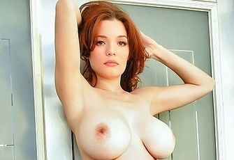Danielle Riley topless redhead big breasts bared in silver panties