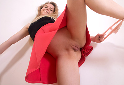 Picture Gallery of Anastasia Andis lifts up her skirt to expose her succulent pussy