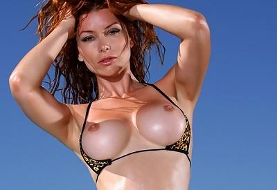 Picture Gallery of Heather Vandeven Strips Exotic Leopard G-string Bikini