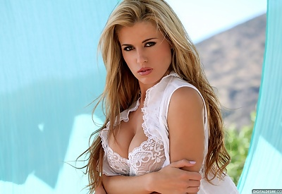 Picture Gallery of Randy Moore Busty Blonde Mesmerizes in White Lingerie