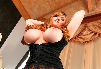 Picture Gallery of Sara Willis Busts Out Of Her Black Bustier