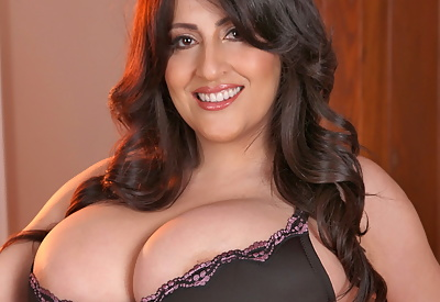 Picture Gallery of Antonella Kahllo in pink and black corset uncovering her huge breasts