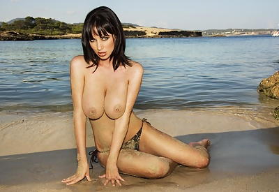 Picture Gallery of Sophie Howard feels best when topless on the beach