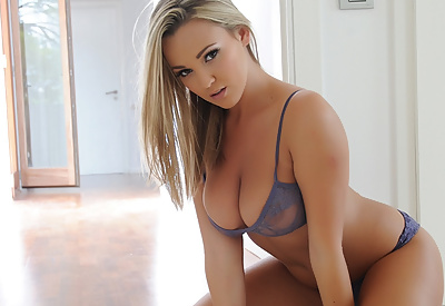 Picture Gallery of Jodie Gasson strips from her sexy blue lingerie