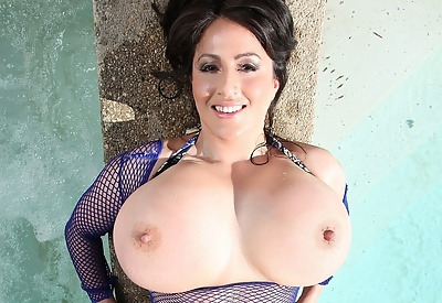 Picture Gallery of Antonella Khalo Busty MILF Teases in Fishnets