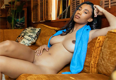 Picture Gallery of Brookliyn Wren exposes her big boobs in a cozy cabin