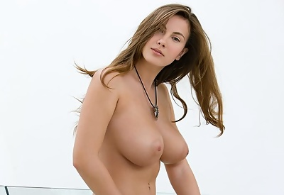 Picture Gallery of Josephine removes white shirt to reveal her big breasts