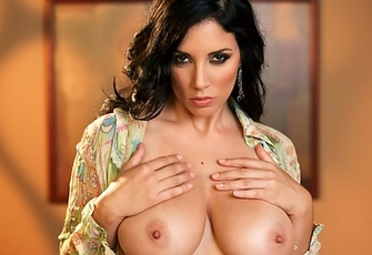 Jelena Jensen unfastens a retro 70s paisley top to run her fingers along her delicious DDs, down her tight, tight tummy and through her hairy bush!