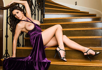 Taya Parker's swanky purple evening dress suffers an intentional wardrobe malfunction while the hot, stacked brunette mounts the stairs of a long winding staircase!