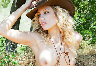 Sexy Kiara Diane is out for a country lane stroll, enjoying the warm sun on her naked body while taking the occasional break in the shade of adjacent treeline.