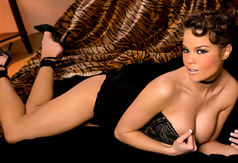 Brea Lynn may be playing a classy, demure 1950s pin-up sex kitten in this orange-tinted photo shoot, but she's an animal once she's unzipped her tight black corset and nestled beneath her tiger striped bedsheets.