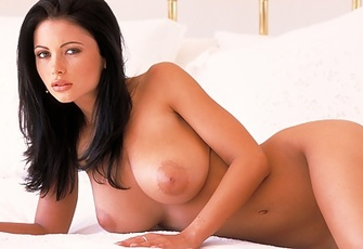 Veronica Zemanova spreads her nude body on a soft bed
