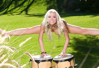 Madison Scott wants you to beat her bongos! She's even going to treat you to a delightful nude drum solo of her own complete with crazy wild spins, jumps and leg splits!