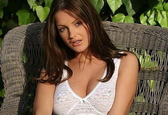 Sandra Shine strips off her white shirt and skirt
