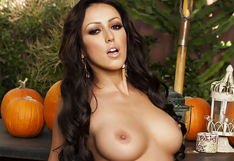 Posing naked on top of a wooden picnic table in the middle of a pumpkin patch, the sexy Breanne Benson flashes her tanned pussy and breasts for the Penthouse cameras!