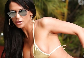 Yummy Rebecca Reign models her gold bikini pool side, then strips it off