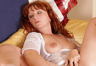Leggy Redhead Milf Fucks Her Mature Pussy With A Dildo