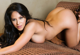 Hot Jenaveve Jolie flops down onto a chaise and strips off her blue mini-dress and panties to pose and play with her round boobs and butt for the Penthouse cameras.