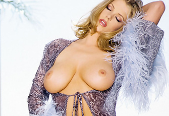 Sydney Moon's well-endowed beautiful chest and glistening pussy will have your full attention as she sashays around with her blue-haired pom-pom boa.