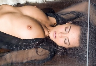 Krista Ayne presses up her naked boobs against the glass of her sliding backdoors.