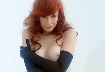Justine Joli purrs, --Opera gloves are sexy, especially when I'm wearing nothing else!-- while bending over to present her clean-shaven pussy and round bottom.