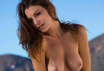 Amber Sym gets naked in a beautiful place