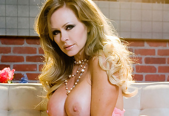 Don't let the brights lights of the big city distract you from the smoking hot Dyanna Lauren! Of course, it's hard to imagine what can turn you away from her ample 38DD boobs, her tight naked body and her sexy haughty, ravish-me attitude.