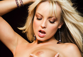 Jana Cova is simply gorgeous as she strikes up a few classic nude poses before sucking on a pink vibrator with gusto and saliva.