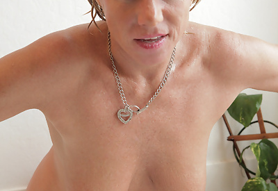 Picture Gallery of Anilos cougar gets wet in the tub and slides a toy in her pussy