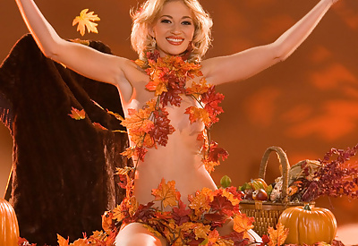 Picture Gallery of Nevaeh is ready for the upcoming holiday season as she rolls around naked on a pile of autumn leaves and garlands.