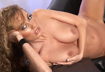 Anita Dark takes off her polka-dot top and black undies to enjoy playing with her perfect naked breasts and pussy on a black leather loveseat all day long.