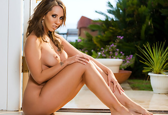 Kelly Divine brazenly shakes and thrusts her plump ass to grab your attention before spinning around and plopping down on it to play with her pussy and boobs!