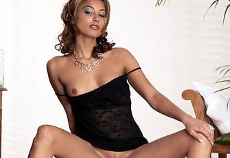 Aneta Smrhova in black micro-mini posing and spreading