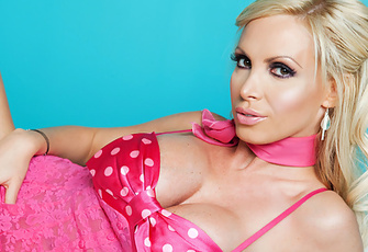 --All I need is some whipped cream and a cherry,-- Nikki Benz remarks, --I'm that sweet,-- as she scoops her two perfect boobs out of her bright magenta polka-dotted bra and jiggles them for our delight!