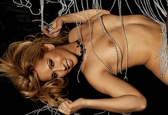 Isis Love ties herself up into a naked sexy love knot with a beaded curtain.