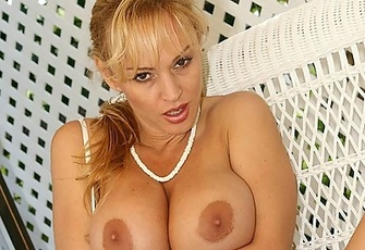 MILF Tanya Danielle showing her massive Boobs