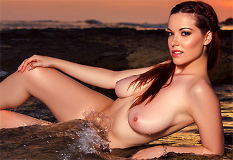 Elizabeth Marxs loses her red bikini on the beach at sunset