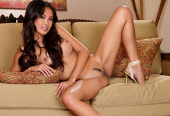 Davon Kim in white lingerie stripping naked on couch