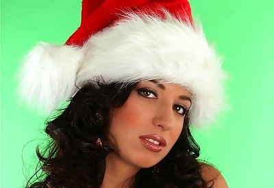 Picture Gallery of Jana Defi festive brunette natural big breasts teased with red gloves